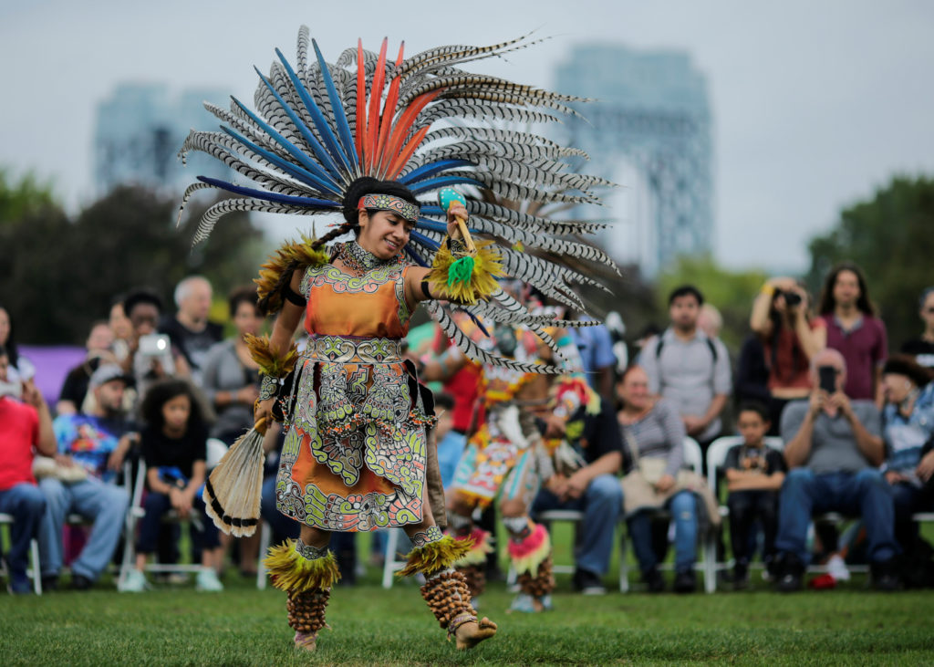 """A reveller performs during a """"pow-wow"""" celebrating the Indigenous Peoples' Day Festival in Randalls Island, in New York indigenous peoples' day"""